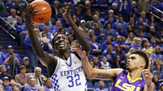 Kentucky's Wenyen Gabriel (32) shoots while pressured by LSU's Wayde Sims (44) during the first half of an NCAA college basketball game, Tuesday, Feb. 7, 2017, in Lexington, Ky. (AP Photo/James Crisp)