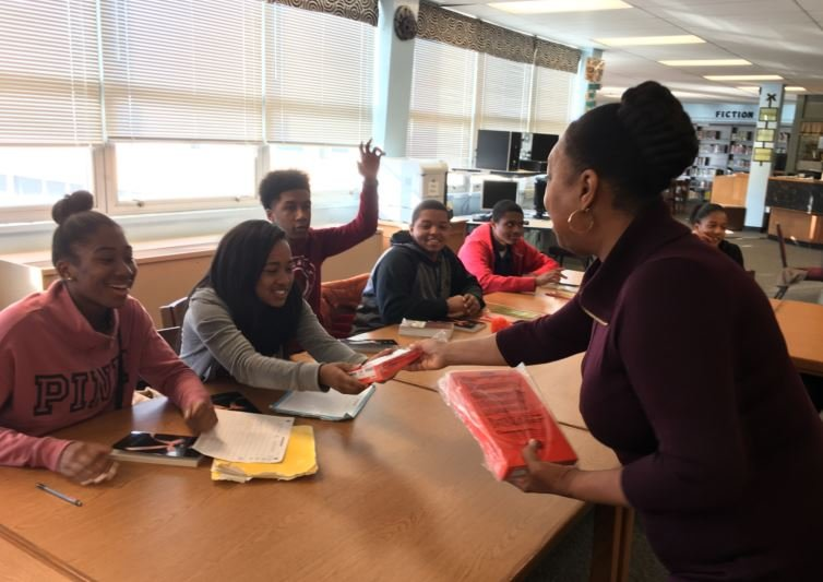 Louisville businesswoman Rae Helton surprised a group of students with Kindle Fire e-books on Thursday (Photo by Toni Konz, WDRB)