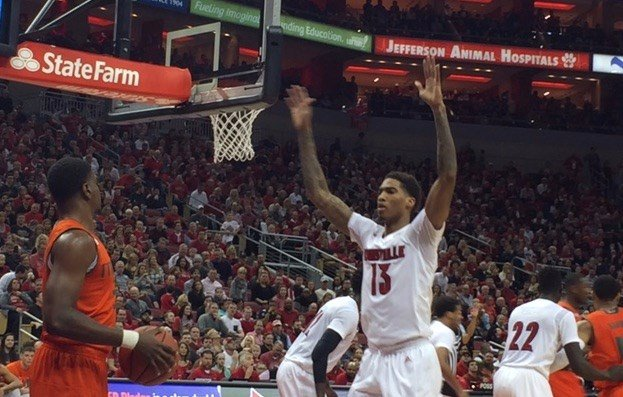 Louisville improved its defense in the second half and rallied to beat Miami.