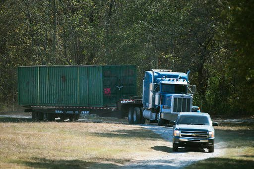 (Lauren Petracca/The Greenville News via AP, File). FILE - In this Wednesday, Nov. 9, 2016 file photo, the shipping container that an abducted woman was held in for two months is removed from Todd Kohlhepp's property in Woodruff, S.C.
