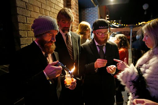 (AP Photo/Brennan Linsley, file). FILE - In this Dec. 31, 2013 file photo, partygoers smoke marijuana during a Prohibition-era themed New Year's Eve invite-only party celebrating the start of retail pot sales, at a bar in Denver.