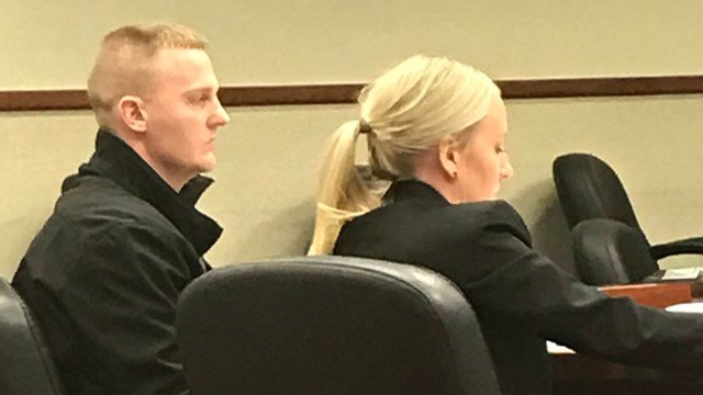 LMPD Detective Zachary Hoppes sitting with prosecutor Emily Cecil in court.
