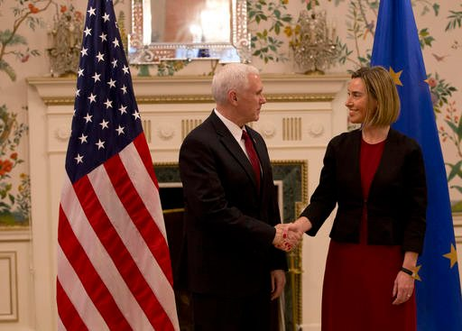 (AP Photo/Virginia Mayo, Pool). United States Vice President Mike Pence, left, shakes hands with European Union High Representative Federica Mogherini during a meeting at US ambassadors residence in Brussels on Monday, Feb. 20, 2017.