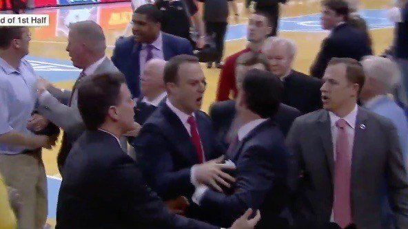 ESPN Screen shot of Louisville coach Rick Pitino reacting to a fan who shouted something at him at halftime of Wednesday night's game at North Carolina.