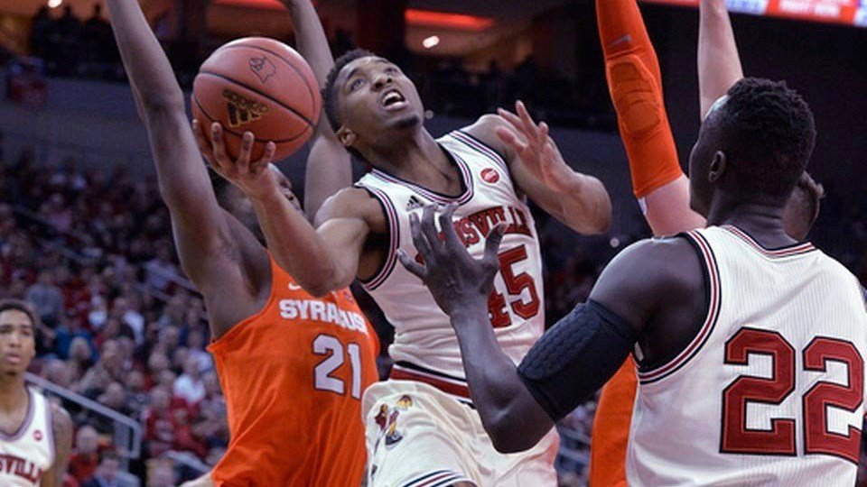 Donovan Mitchell drives against Syracuse (AP photo)