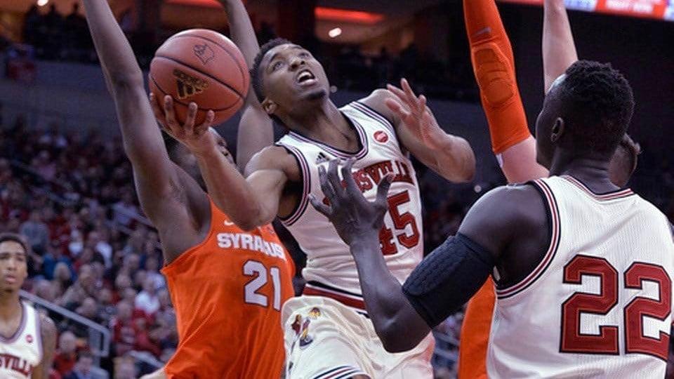 Donovan Mitchell drives against Syracuse (AP photo)