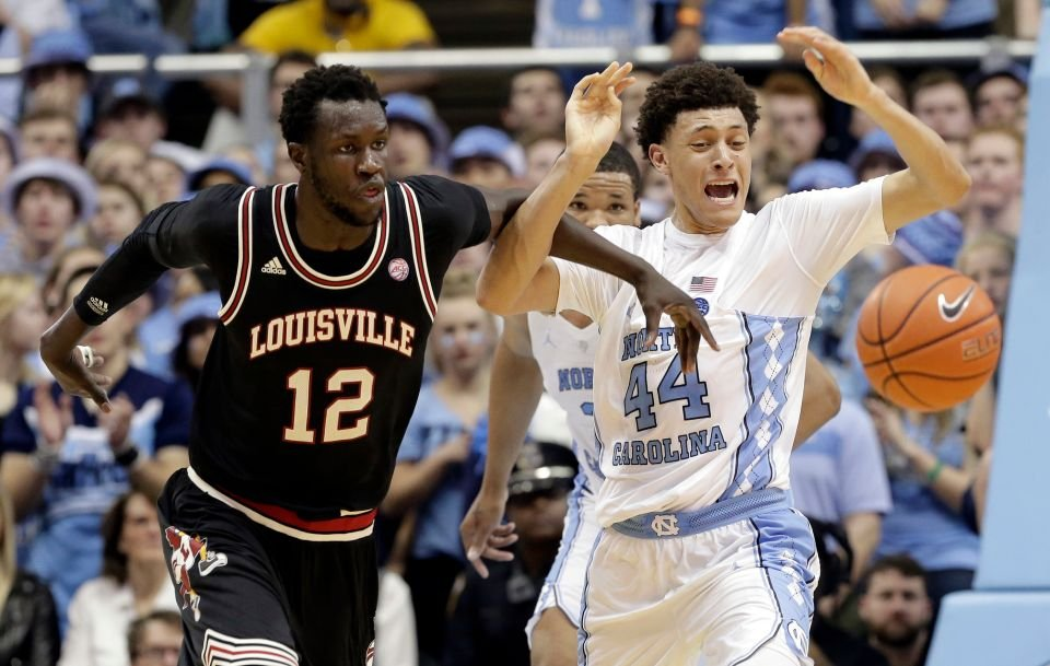 Throwback road uniforms Louisville wore at North Carolina (AP photo)
