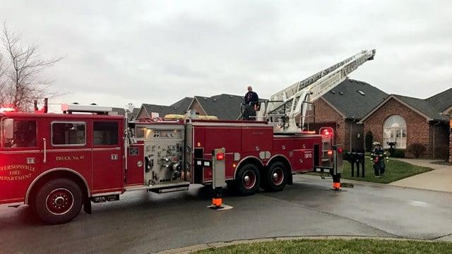 Jeffersonville firefighters outside a home on Aspen Way.