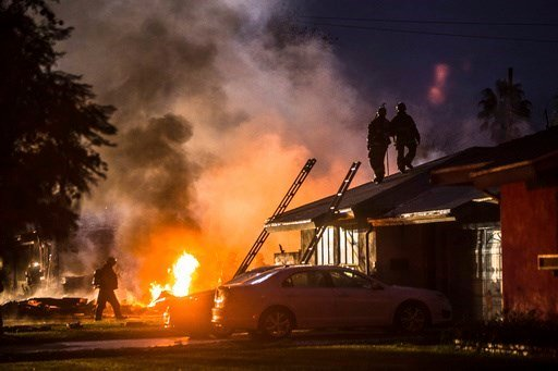 (Watchara Phomicinda/The Press-Enterprise via AP). Smoke rises from a fire after a plane crashed in Riverside, Calif., Monday, Feb. 27, 2017. The deadly crash injured several when a small plane collided with two homes Monday.