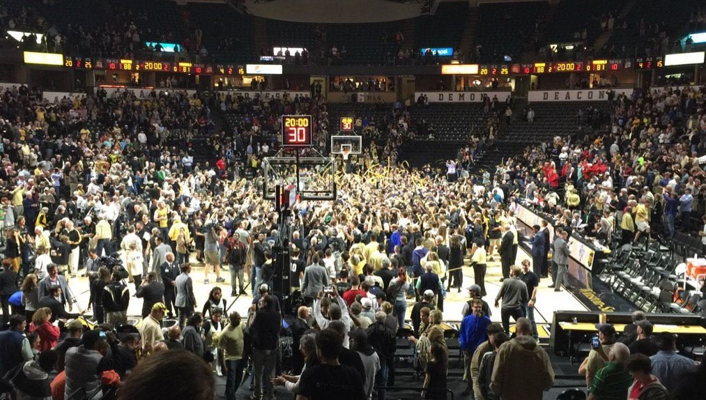 Wake Forest fans stormed the court after the win (Photo by Eric Crawford).