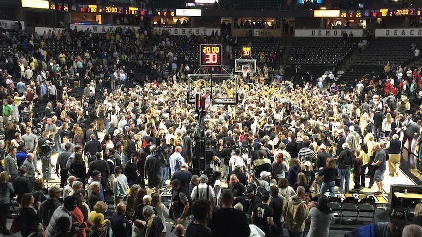 Wake Forest fans stormed the court after the Demon Deacons upset Louisville. (WDRB photo by Eric Crawford)
