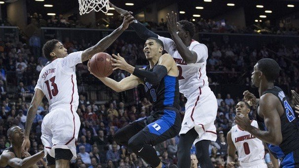 Jayson Tatum scored two of his 25 points against U of L's  Ray Spalding (left) and Mangok Mathiang. (AP Photo.)
