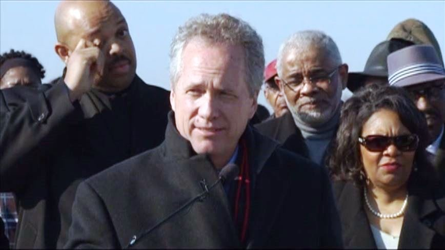 With Frank and Teresa Bridgewaters to the right, Mayor Greg Fischer announced the planned Walmart in 2014.