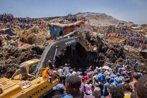 AP Photo/Mulugeta Ayene). In this Sunday, March 12, 2017 photo, rescuers work at the scene of a garbage landslide, on the outskirts of the capital Addis Ababa, in Ethiopia.