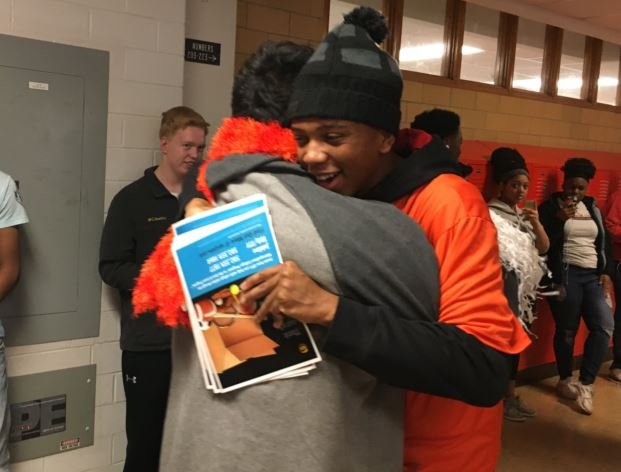 Fern Creek's Jarius Jones gets a hug on Wednesday morning (Photo by Toni Konz, WDRB News)
