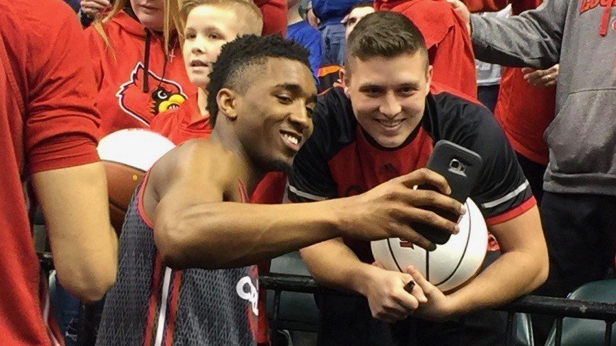 Louisville's Donovan Mitchell takes time for a selfie with a fan after yesterdays' NCAA Tournament practice at Bankers Life Fieldhouse. (WDRB photo by Eric Crawford)