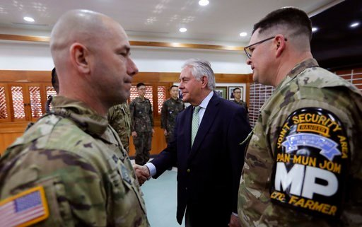 (AP Photo/Lee Jin-man, Pool). U.S. Secretary of State Rex Tillerson, center, meets with U.S. and South Korea soldiers.