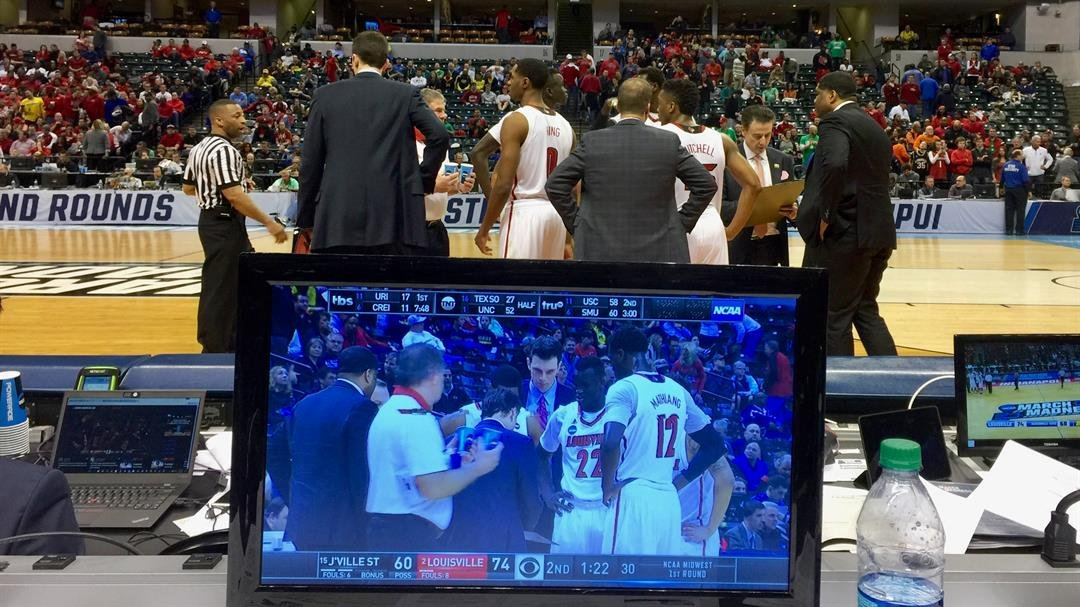 From this courtside seat, you could see two angles of Louisville's team huddle. (WDRB photo by Eric Crawford)