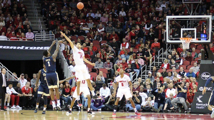 Louisville's Anas Mahmoud closes out on a three-pointer against Pittsburgh. (WDRB photo by Eric Crawford)