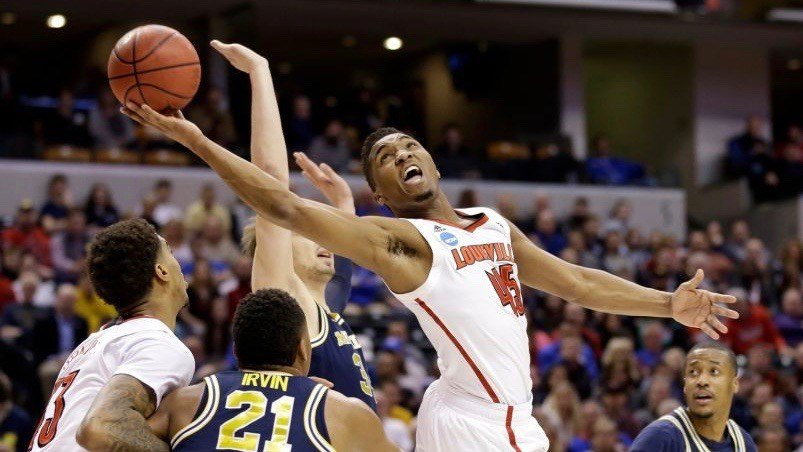 Slipping away: Donovan Mitchell battles for a basket in traffic. (AP photo by Michael Conroy).