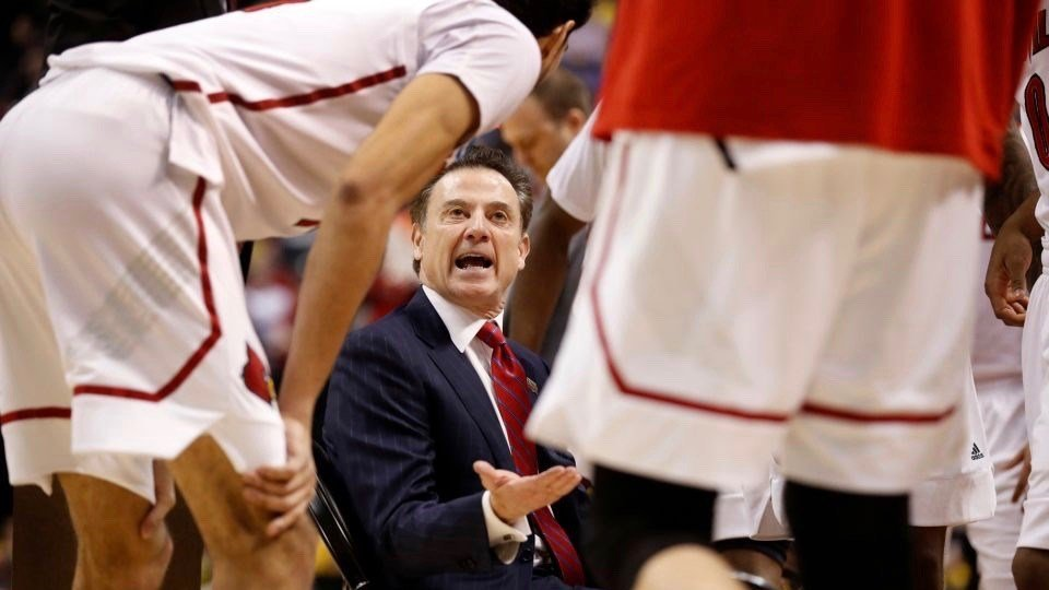 Making a point: Rick Pitino talks to his team during a timeout. (AP photo by Michael Conroy)