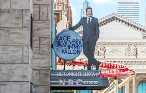 """(Universal Orlando Resort via AP). This undated photo made available by Universal Orlando Resort, shows the new """"Race Through New York Starring Jimmy Fallon"""" ride in Orlando, Fla. Universal is leading the theme-park charge into """"virtual lines."""""""