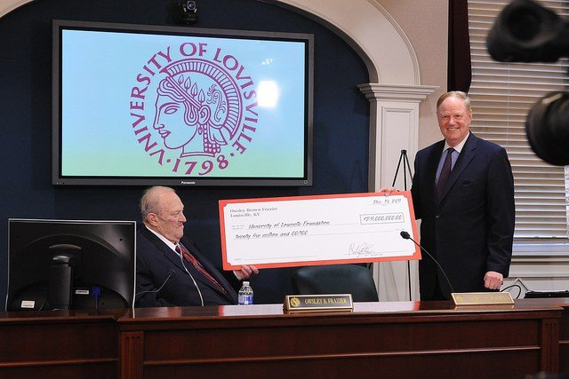 The late Owsley Brown Frazier, left, announced a $25 million gift to the University of Louisville in 2011. Frazier said former U of L President James Ramsey, right, could decide how to spend the money. (U of L photo)