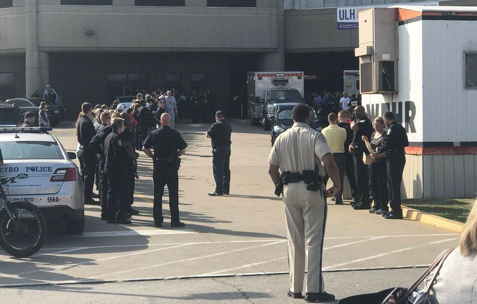 Officers lined the exit to the emergency room, waiting for Officer Rodman to be escorted.