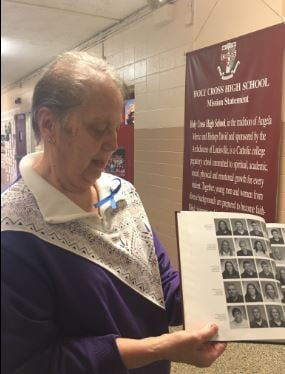 SisterMaryanne Tarquinio points to a yearbook picture of Nick Rodman, who graduated from Holy Cross in 2005. (Photo by Toni Konz, WDRB News)