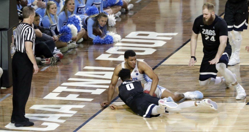 On a night when the officials could not stop blowing their whistles, they missed this critical call in the final minutes of North Carolina's win over Gonzaga. (AP photo.)