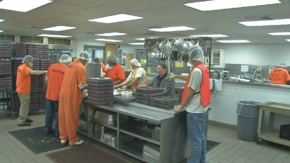Hardin County inmates working in the jail's kitchen.