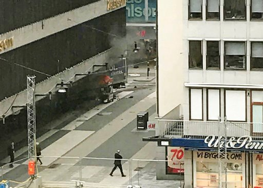 Andreas Schyman, TT News Agency via AP). People look on at the scene after a truck crashed into a department store injuring several people in central Stockholm, Sweden, Friday April 7, 2017.
