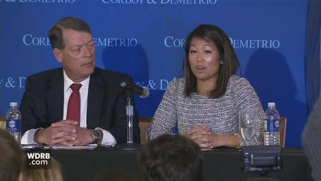 Crystal Dao, the daughter of Dr. David Dao, who was dragged from a United airlines flight, with an attorney during a news conference on April 13, 2017.