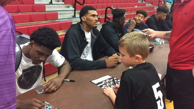 Louisville recruits (from left) Darius Perry, Malik Williams and Lance Thomas competed at IUS Friday night.