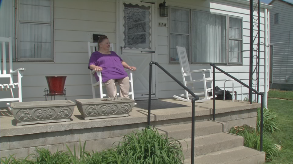 Beverly Cairnes sits on her front porch in the Pleasant Ridge neighborhood where she has lived for 62 years.