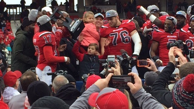 Forrest Lamp (76) celebrated with former WKU coach Jeff Brohm after the Hilltoppers won the Conference USA title last December.