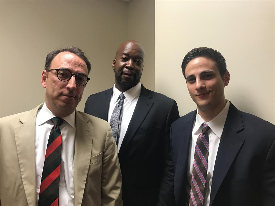Attorney Ted Shouse, Michael Brizendine and attorney Eric Sandberg-Zakian in the courthouse shortly after Brizendine is freed