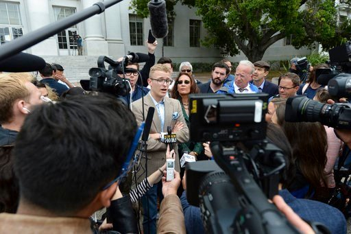 (Dan Honda/East Bay Times via AP). Troy Worden, left, president of the Young Republicans and their attorney Harmeet Dhillon, right, talk with the media during a press conference held by the Berkeley College Republicans in Sproul Plaza