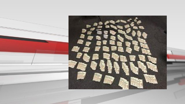 Police seized $10,000 in cash along with cocaine during a traffic stop in Floyds Knobs, Ind. on April 27, 2017.