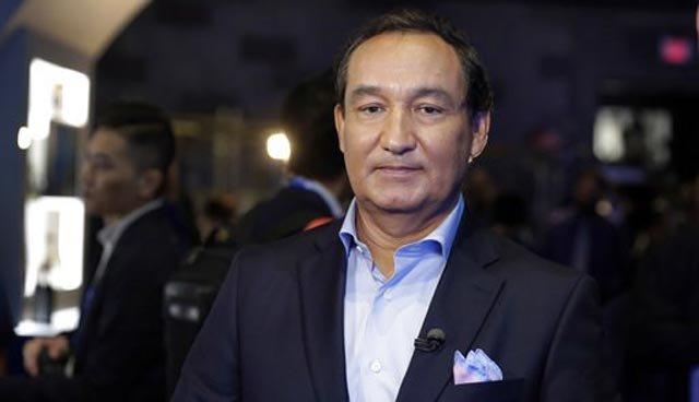 (AP Photo/Richard Drew, File). FILE - In this June 2, 2016, file photo, United Airlines CEO Oscar Munoz waits to be interviewed in New York.