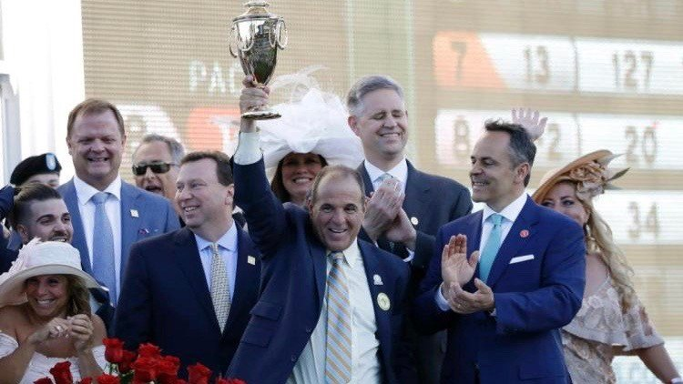 Anthony Bonomo, co-owner of Always Dreaming, hoists the winning trophy after the colt won the Kentucky Derby. (AP photo)