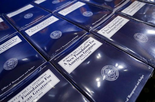 (AP Photo/Pablo Martinez Monsivais). Copies of President Donald Trump's fiscal 2018 federal budget are laid out ready for distribution on Capitol Hill in Washington, Tuesday, May 23, 2017.