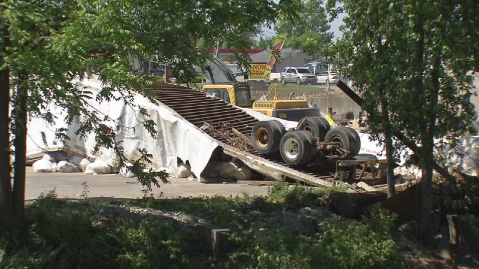 A semi truck is over turned, swept away by flood waters Friday evening.