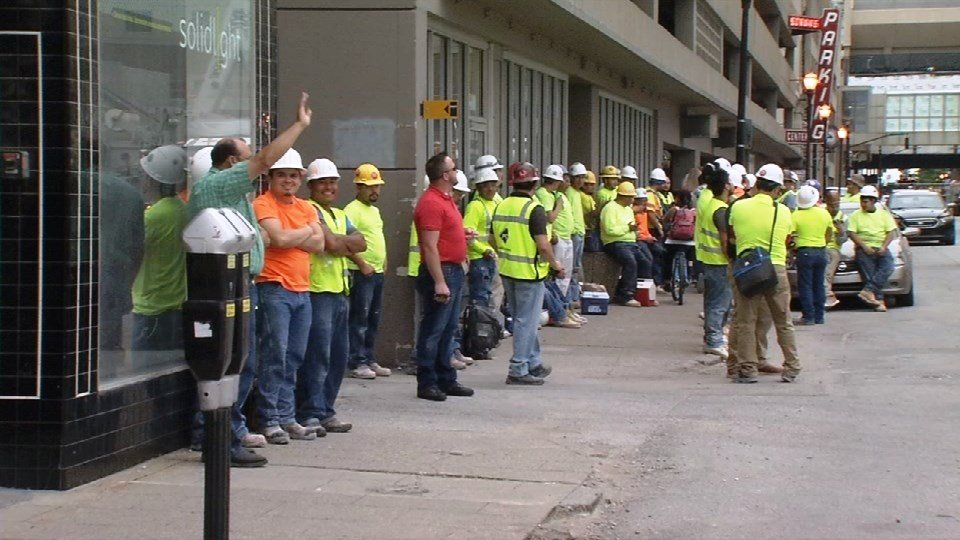 Workers outside the Omni Hotel on Wednesday, May 24, 2017