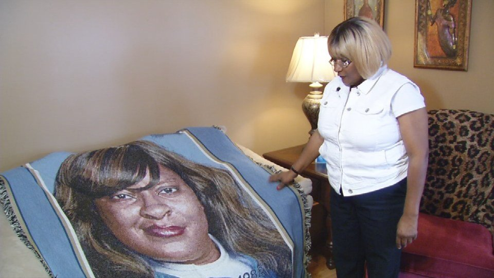 Maguerite Malone, the mother of the victim, keeps a blanket with her daughter's face on it close.