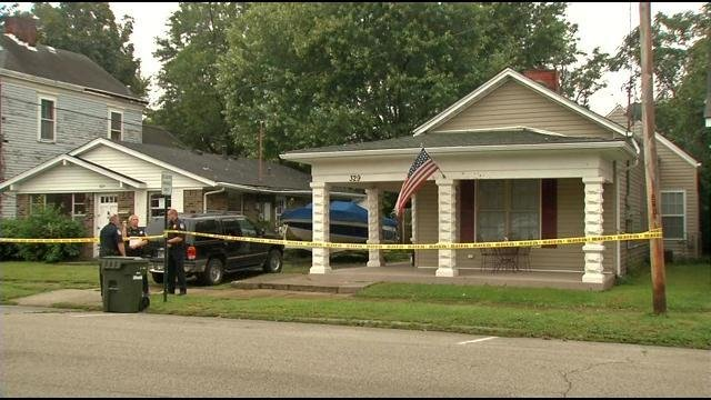Jeffersonville detectives discovered a grisly crime scene at this home on Locust Street on Sept. 11, 2014.