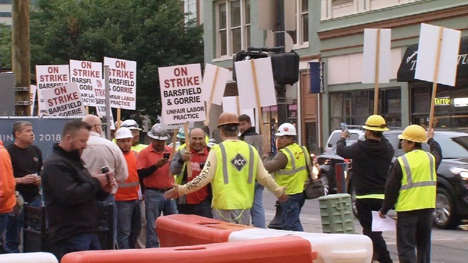 Drywall workers, joined by supporters, on strike at the Omni Hotel project Thursday, May 25, 2017.
