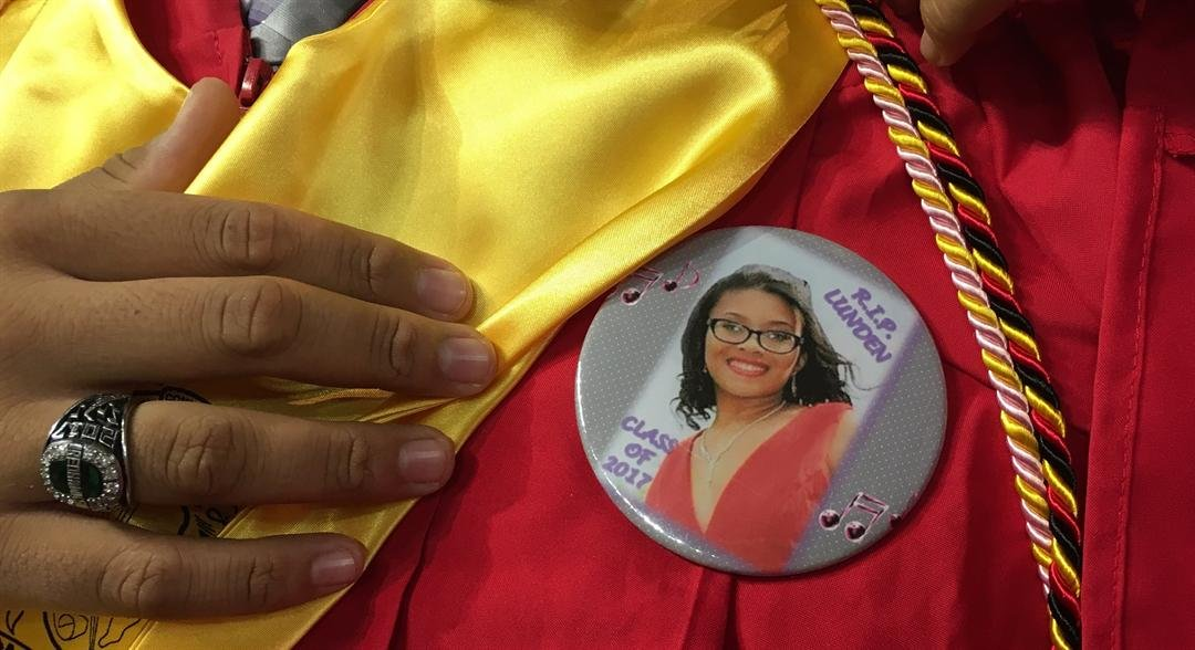 Seneca High seniors wore a pin with a photo of Lunden Pope on their gowns (Photo by Toni Konz, WDRB News)