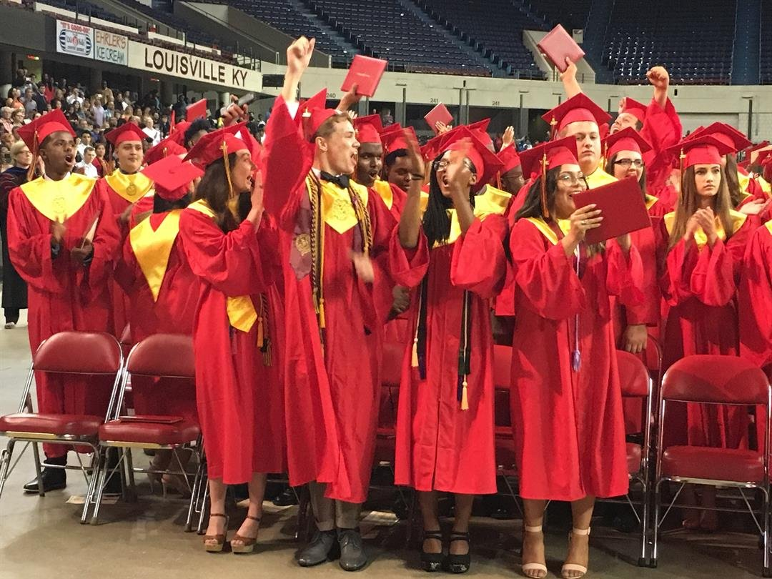 Seneca High School graduates celebrate after receiving their diplomas on Thursday, May 25, 2017