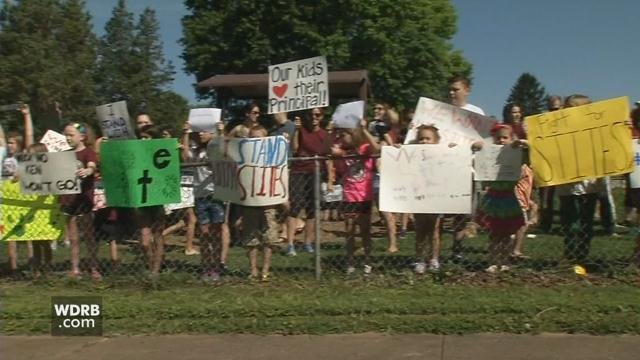 Students, parents and staff from Norton Elementary School protest the firing of Ken Stites in a rally held outside the school on June 1, 2017